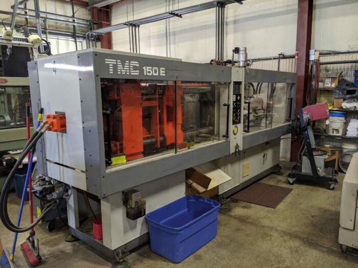 used 165 ton tmc 150 e injection molding machine