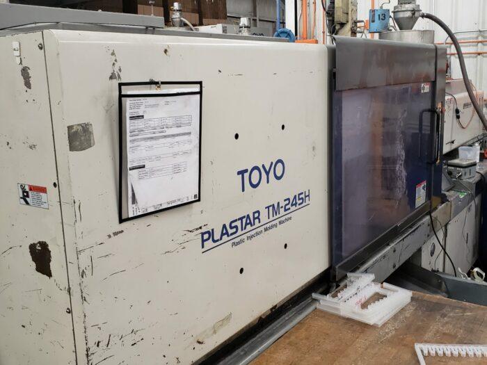 used 245 ton toyo tm245h injection molding machine