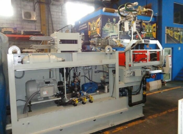 rebuilt uniloy 250-r1 2 head reciprocating screw intermittent extrusion blow molding system